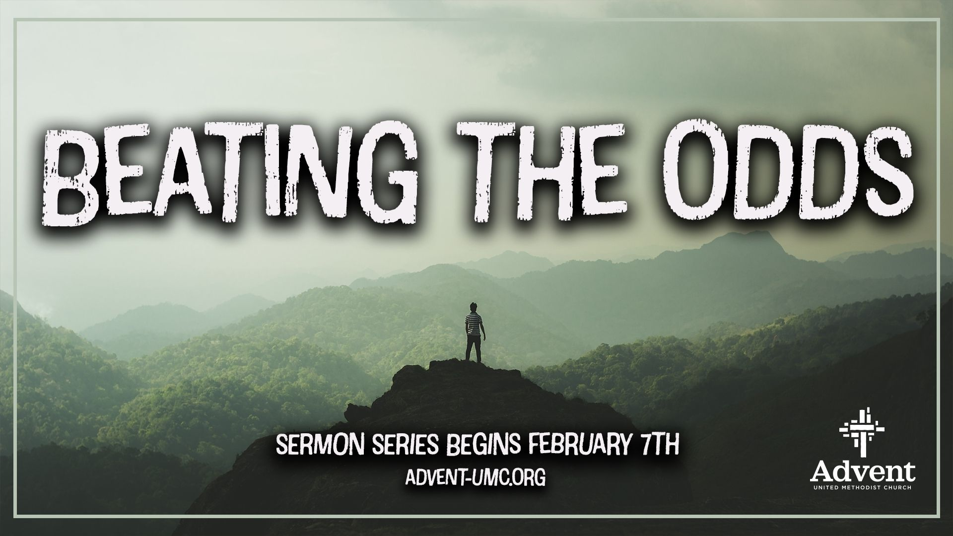 Beating the Odds - Man standing amongst the mountains